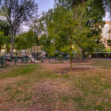Residents playing at the Children's Playground | Apartment Homes In Portland | Park Plaza