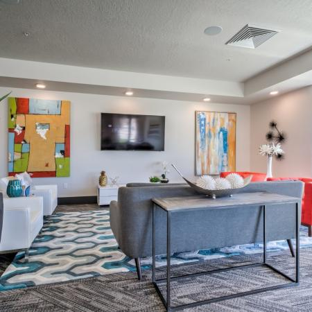 Residents Relaxing in Club Room | West Jordan UT Apartments | Novi at Jordan Valley Station