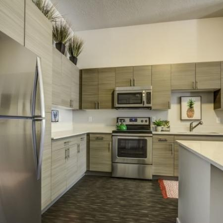 Residents Cooking in the Kitchen | Apartments For Rent West Jordan Utah | Novi at Jordan Valley Station