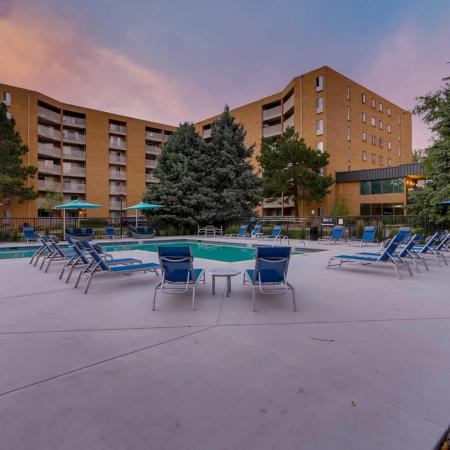 Lounging by the Pool | Denver CO Apartments For Rent | Woodstream Village Apartments