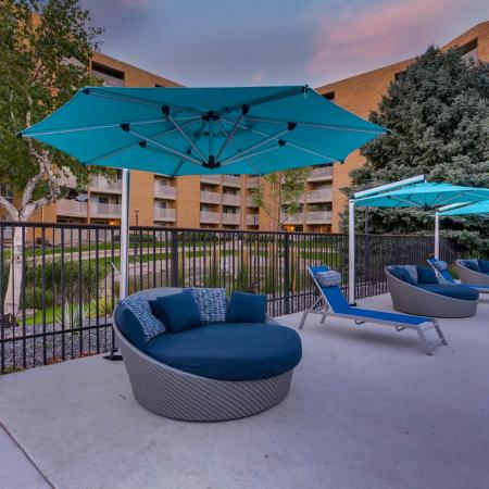 Seating by the Pool | Denver CO Apartments For Rent | Woodstream Village Apartments