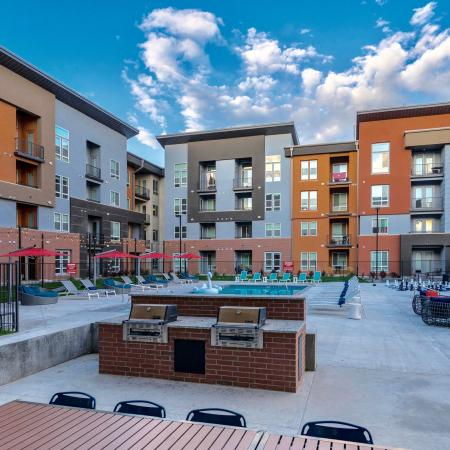 Lounging by the Pool | Apartments West Jordan | Novi at Jordan Valley Station