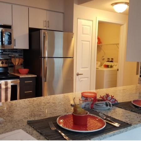 One Bedroom kitchen and laundry room