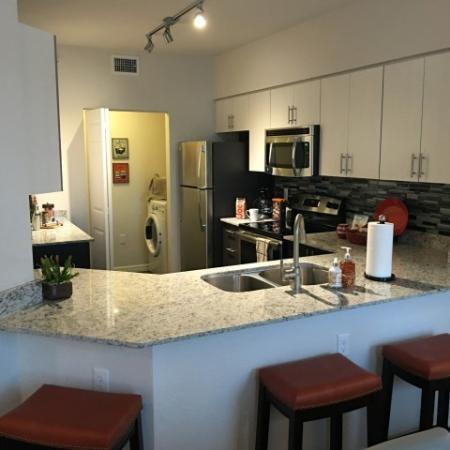 Modern white upper cabinets and grey lower cabinets