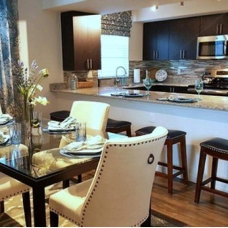 Residents Having Dinner in the Dining Room | Apartment Homes In Wellington | The Quaye at Wellington