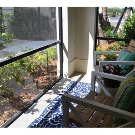 Resident Relaxing on the Porch | Apartment Homes In Wellington | The Quaye at Wellington
