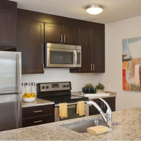 Modern kitchens with stainless appliances, granite counters, breakfast bar and pantry