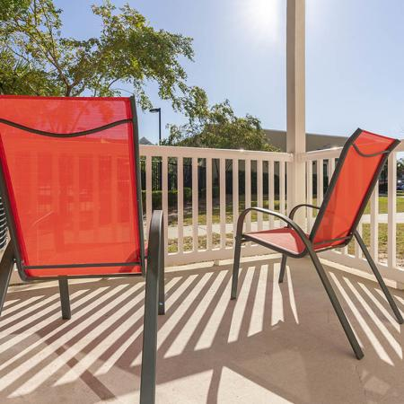Resident Relaxing on the Balcony | Wilmington NC Apartment Homes | Aspire 349