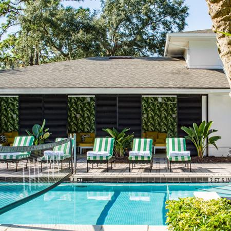 1800 The Ivy, exterior, sparkling blue swimming pool, lounge chairs, shaded pavilion seating, palm trees, trees