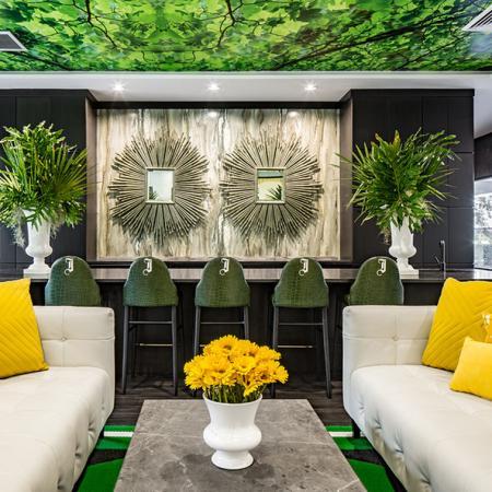 1800 The Ivy, interior, white, black, yellow, green decor, sofas, pillows, bar seating,