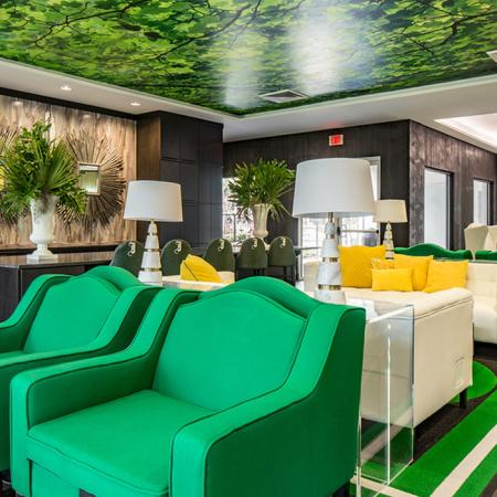 1800 The Ivy, interior, white, black, yellow, green decor, sofas, pillows, bar seating,