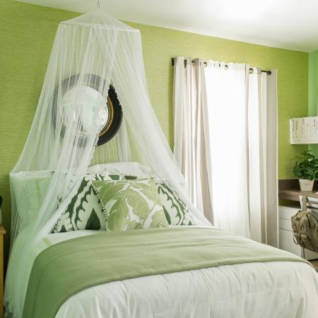1810 The Social, interior, bedroom, green and white decor, bed, bed curtain, desk, chair, shelves, night stand