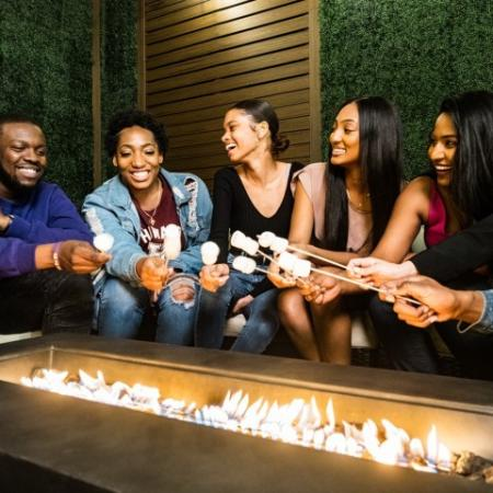 Residents Cooking Smores by the Fire | Hyattsville MD Apartments For Rent | Vie at University Towers LLC