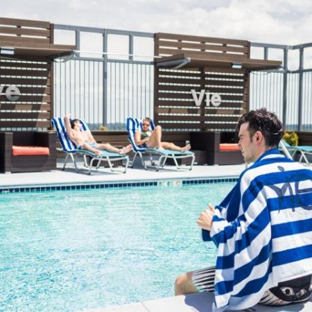 Residents Tanning by the Pool | Hyattsville MD Apartments | Vie at University Towers LLC