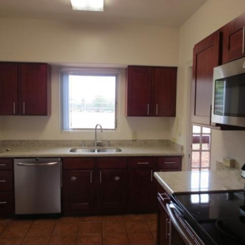 4-Bedroom Senior Officer Home on Schofield Barracks, kitchen with cherry cabinets, stainless appliances