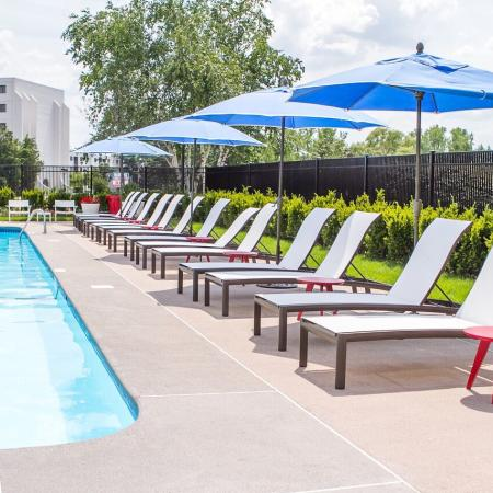 Apartment Pool Area With Umbrellas and Chairs