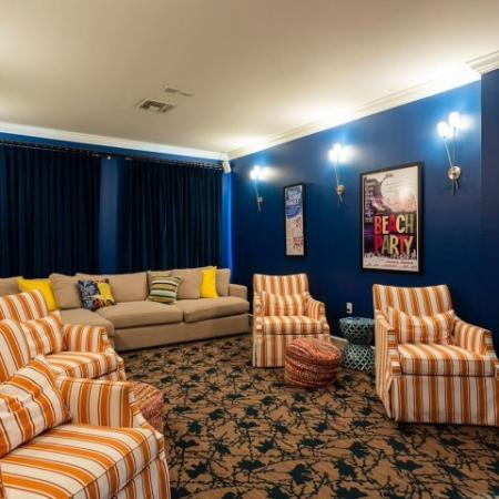 Cabana West Apartments interior: clubhouse theatre with several chairs, couches, and pillows