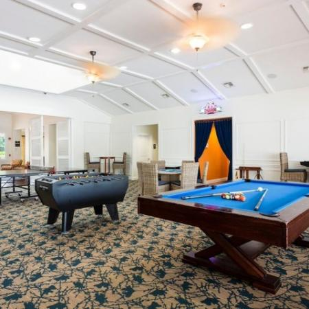 Cabana West Apartments interior: clubhouse with pool table, foosball, ping pong, and several tables and chairs