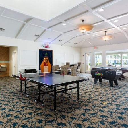 Cabana West Apartments interior: another view of the clubhouse with ping pong, foosball, pool table, and water fountains.