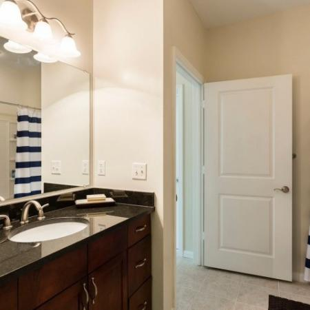 Cabana West Apartments interior: another view of bathroom with shower curtain, sink, one large mirror