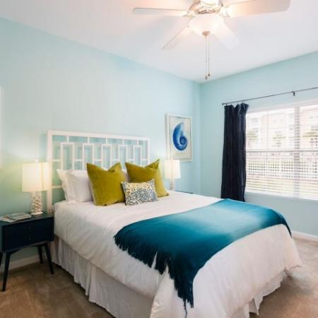 Cabana West Apartments interior: another view of the bedroom with bed, large windows, and blinds