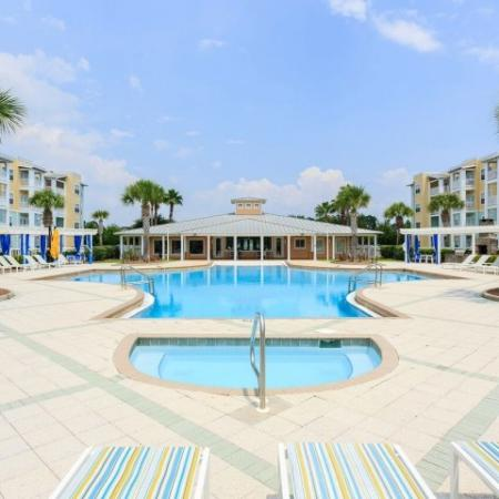 Cabana West Apartments exterior: large pool and jacuzi area with beautiful landscape