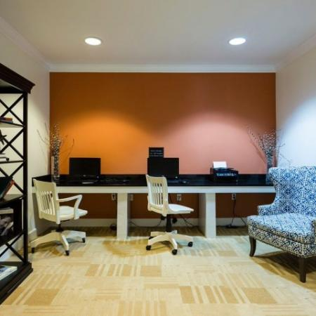 Cabana West Apartments interior: study area setup with laptops and a printer