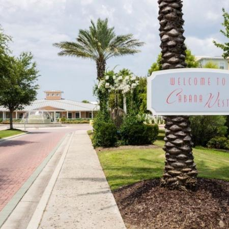 Cabana West Apartments exterior: view of the entrance to the property as you drive in with beautiful well kept landscape.