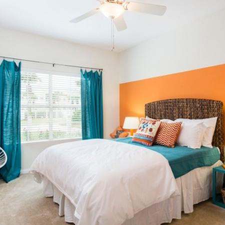 Cabana West Apartments interior: bedroom with large window and blinds