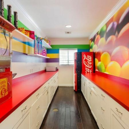 Cabana West Apartments interior clubhouse with popcorn machine, soda vending machine, and colorful paint