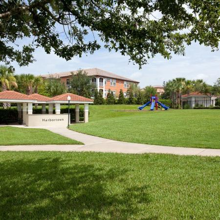 Harbortown Luxury Apartments, exterior, grass, walkway, property sign, pavilion, trees, playground equipment, buildings