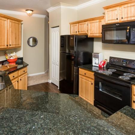 Grandeville at River Place Interior | Kitchen | Black appliances | Hardwood floor | Counter space