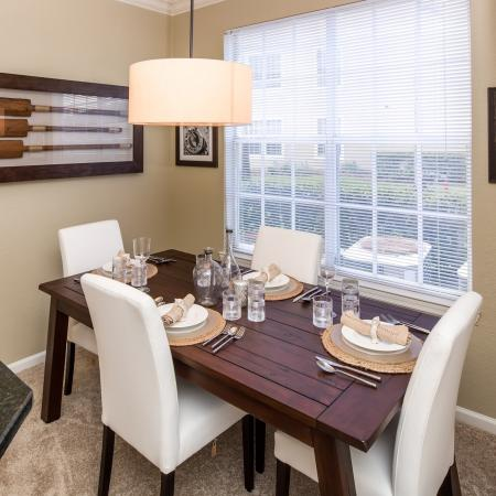 Grandeville at River Place Interior | Dining room | Tbale and chairs | Window | Hanging light | Carpet