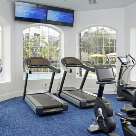 Grandeville at River Place Interior | Fitness Center | Workout Equipment | Carpet | TV | Windows
