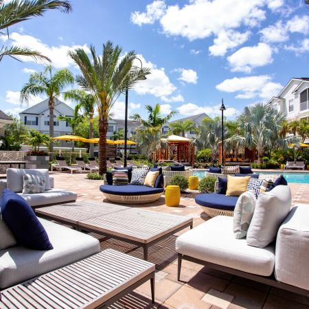 Grandeville at River Place Exterior   Outdoor pool   Lounge in pool area   Palm trees   Couches   Coffee tables
