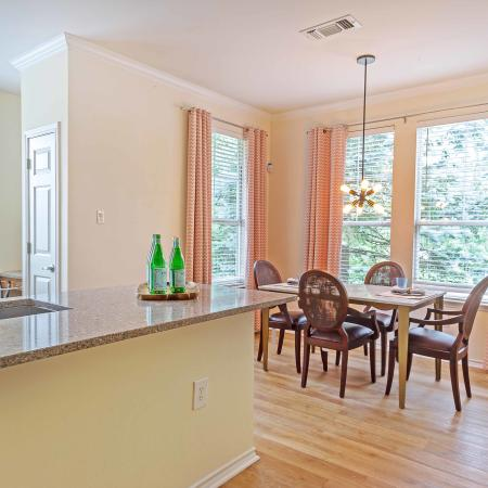 Kitchen And Dining With Hardwood Floors at Jefferson at Westtown