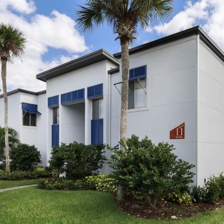 Lakeside villas | exterior Building | white Building with palm trees and bushes in front.