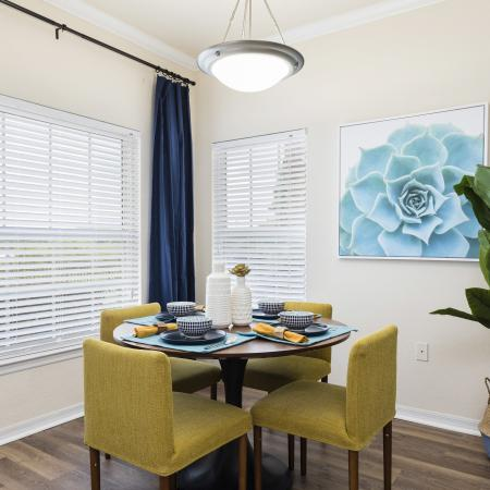 Harbortown Luxury Apartments, interior, dining room, yellow, blue, white decor, table for four, large windows, wood floor