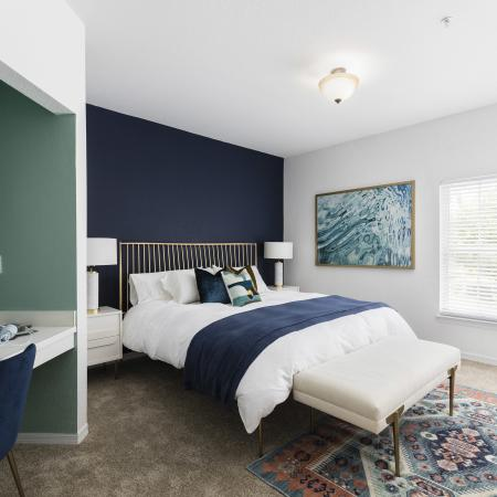 Harbortown Luxury Apartments, interior, bedroom, white, blue, green decor, large window, area rug, desk, chair, record player