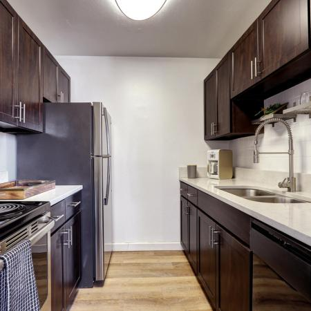 Golden Apartment Kitchen - The Summit at Red Rocks
