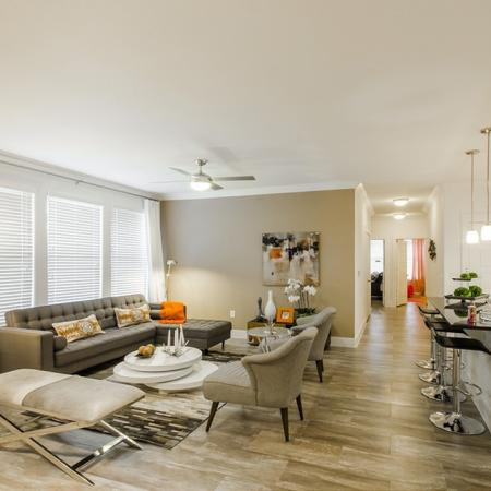 Residents Lounging in the Living Room   Apartments In Conroe Texas   The Towers Woodland