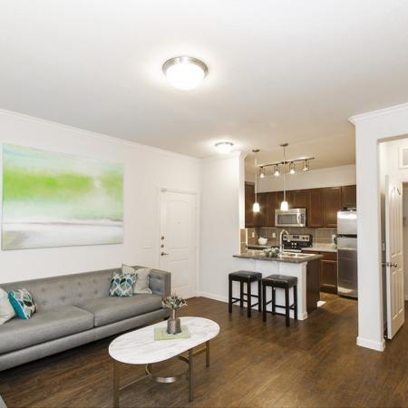 Residents Lounging in the Living Room | Apartments In Magnolia Texas | The Grand Estates Woodland