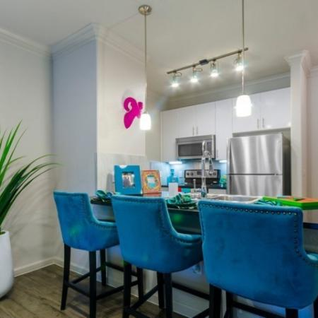 Residents Snacking in the Kitchen | Mckinney Apartments | The Mansions McKinney