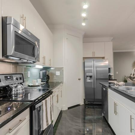 Residents Snacking in the Kitchen | Apartments For Rent In Seabrook TX | The Towers of Seabrook
