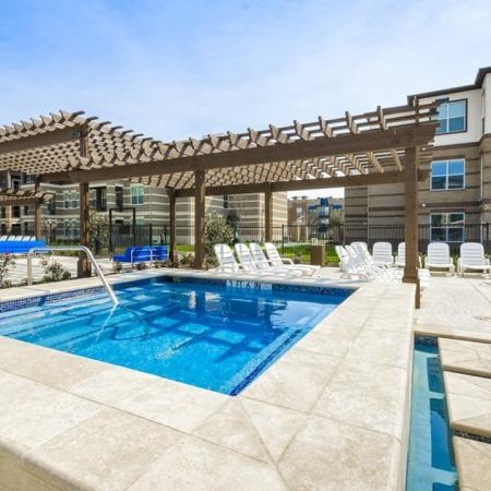 Lounging by the Pool | Apartments McKinney | The Mansions McKinney