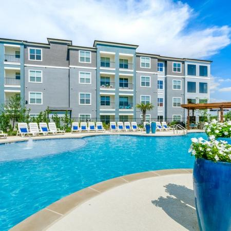 Lounging by the Pool | Little Elm Apartments | The Luxe 3Eighty