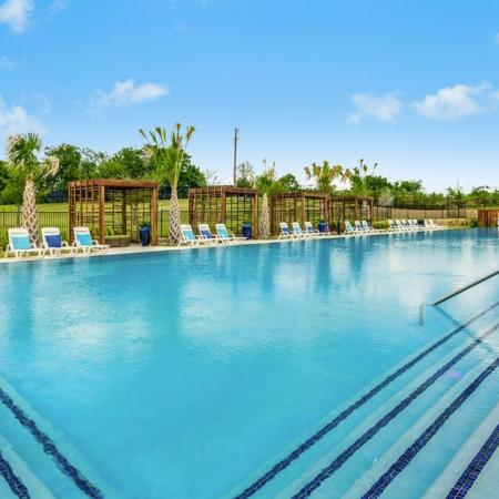 Lounging by the Pool | Little Elm Apartments | The Mansions 3Eighty
