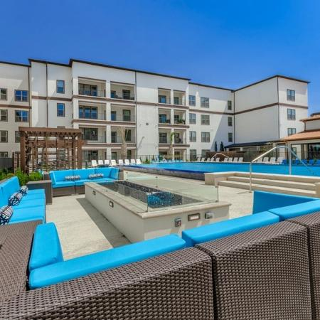 Tanning by the Pool   Apartments In Garland   The Towers at Spring Creek