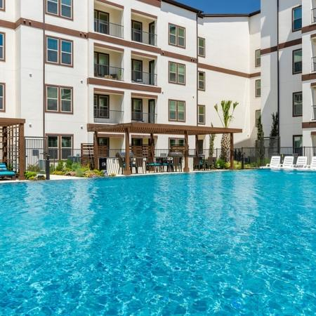 Sparkling Pool   3 Bedroom Apartments In Garland TX   The Towers at Spring Creek