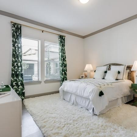 Elegant Bedroom   Apartments In Garland Texas   The Towers at Spring Creek